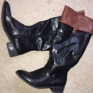 Leather black and brown boots.